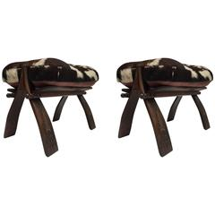 Pair of Camel Saddle Seat Footstools with Cowhide Cushions