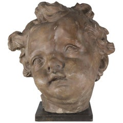 Terra Cotta Cherub Face on Steel Metal Base