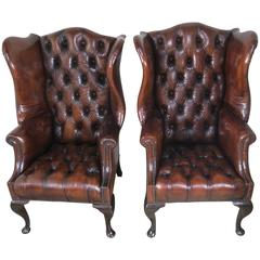 Pair of English 1900s Wing Back Leather Tufted Armchairs