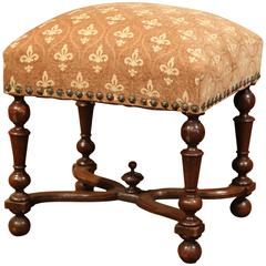 19th Century French Carved Walnut Stool with Fleur-de-Lys Pattern Fabric