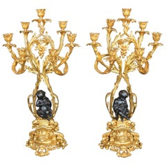 Pair of Bronze Putti Candelabras
