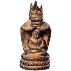 Lacquered and Gilded Wood Buddha Seated in a Naga Shrine