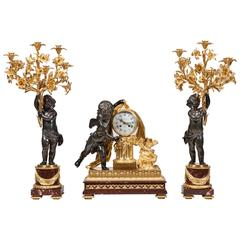 French 19th Century Bronze and Ormolu Clock and Matching Candelabra