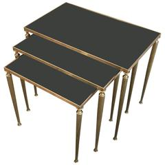 Set of Black Glass and Brass Nesting Tables in the Style of Maison Jansen