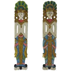 Pair of Indonesian Carved and Painted Plaques