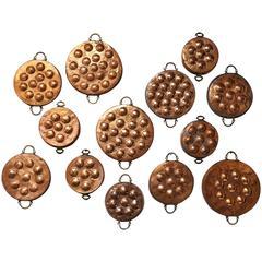 Collection of Thirteen 19th Century Copper Egg Poacher Pans