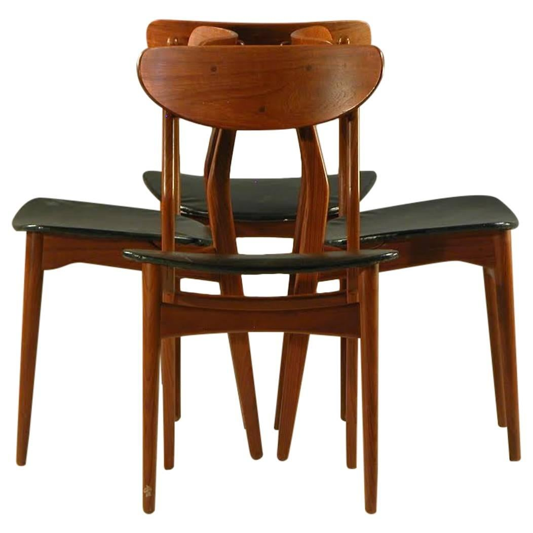 1960s Set of Eight Danish Dining Chairs in teak and Black Leatherette