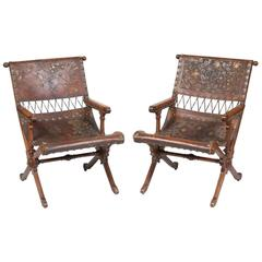 Fine Pair of Aesthetic Movement Walnut and Embossed and Gilt-Leather Armchairs