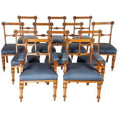 Twelve Victorian Gothic Revival Oak Dining Chairs