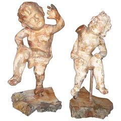 Pair of Carved and Giltwood Cherubs or Putti on Stand
