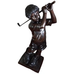 Life-Size and Signed Bronze Sculpture of Golf Playing Boy in His Father's Shoes
