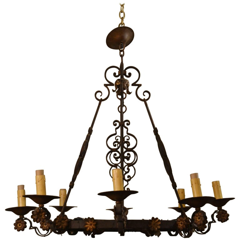 Antique French Wrought Iron Eight Light Fixture with Floral Detail For Sale