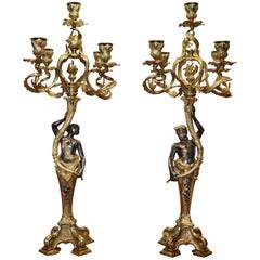 Pair of Rococo Gilt Bronze Candelabra with Patinated Figures