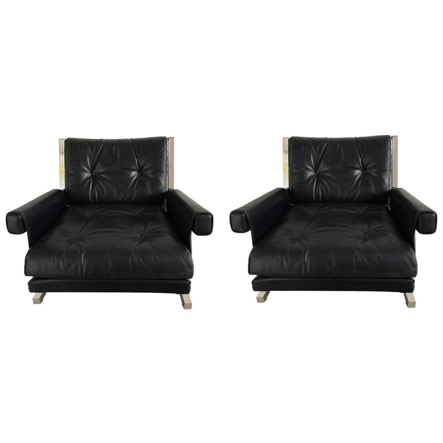 Pair of Leather Armchairs by Jacques Quinet