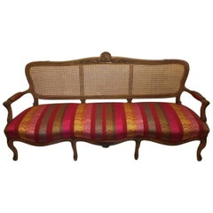 Early 20th Century French Louis XV Style Caned Back Settee