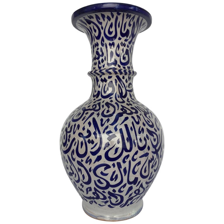 Large Moroccan Ceramic Vase from Fez with Blue Calligraphy Writing on glass for sale, candlesticks for sale, earrings for sale, glass vase sale, statuary for sale, vintage bowls for sale, decorative teapots for sale, figurines for sale, plants for sale, spoons for sale, tiles for sale, silver for sale, pedestals for sale, home decor for sale, coins for sale, pewter dragons for sale, storage for sale, stationery for sale, jugs for sale, stencils for sale,