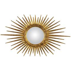 French 1940s Giltwood Convex Oval Sunburst Mirror with Gold Leaf Finish