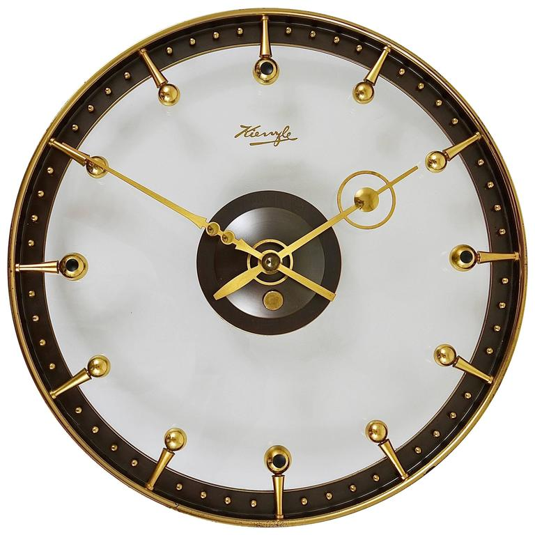 Outstanding mid century brass and glass wall clock by for Kienzle wall clock made in germany