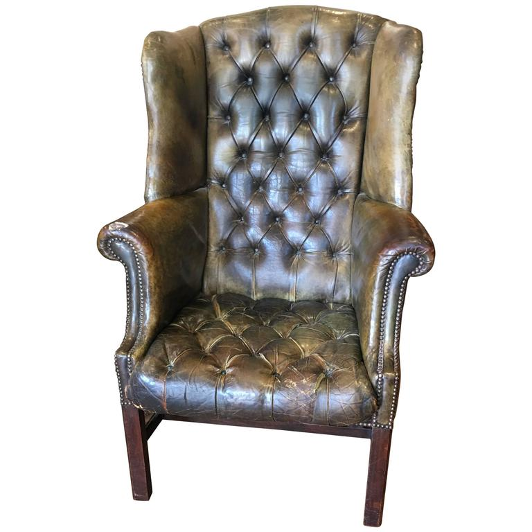 Tufted Leather Wingback Chair With Mahogany Legs