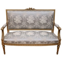 Louis XVI-Style French Giltwood and Parcel Paint Settee with New Upholstry