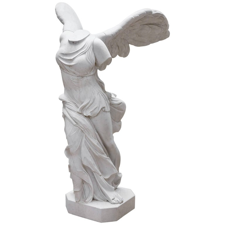 White Marble Statue : Lifesize hand carved white carrara marble statue of winged