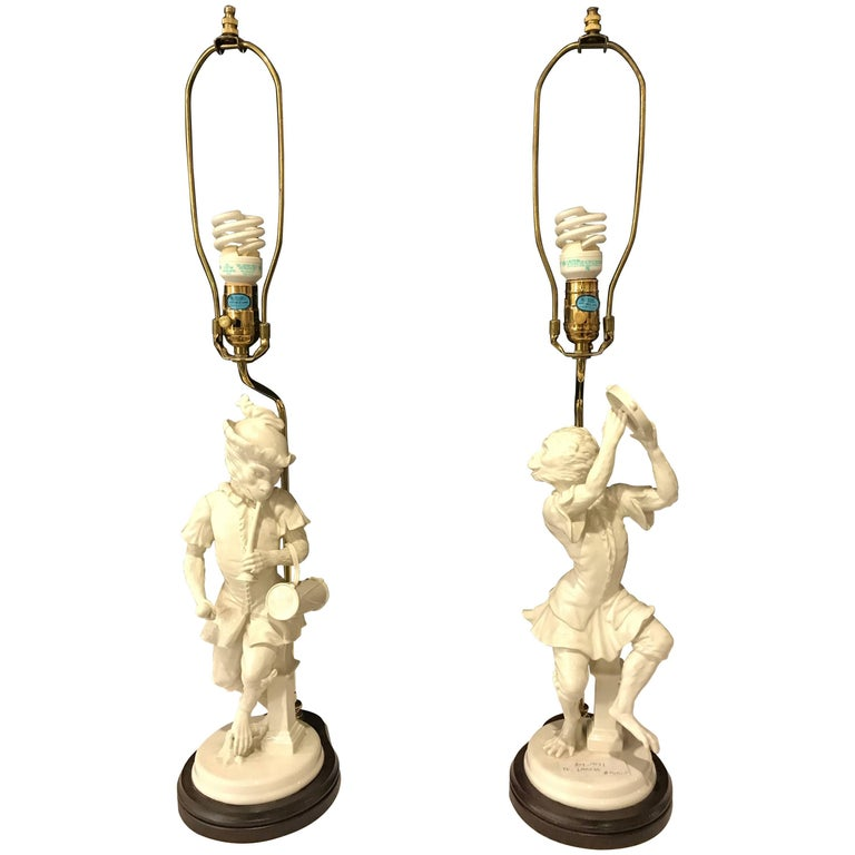 Pair of White Porcelain Opposing Monkey Lamps