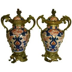 Impressive and Decorative Pair of Imari Baluster Vases with Ormolu Mounts