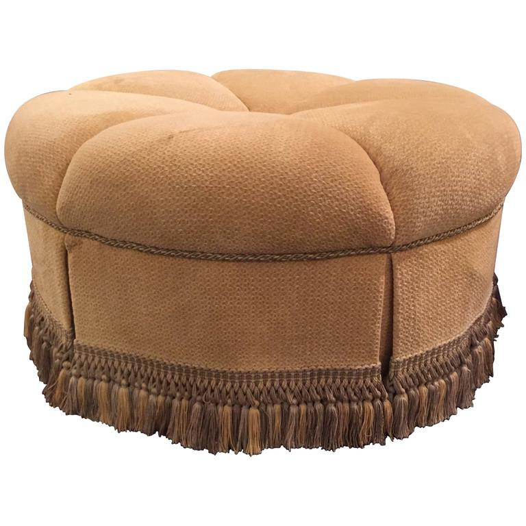 Circular Finely Upholstered and Lined Ottoman or Poof with a Tassel Fringe Base