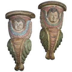 Pair of Vintage Polychrome Carved Figural Cherub Candle Wall Shelves, circa 1950