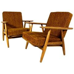 Pair of  Hans J Wegner Cigar Lounge Chairs Model GE 240 in Oak and Fabric