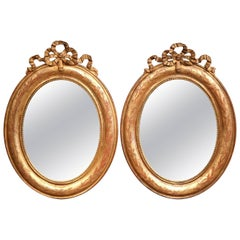 Pair of 18th Century French Louis XVI Giltwood Oval Mirrors with Ribbon Bows