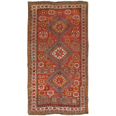 Antique Qashqai Rug with Geometric Motifs in Red, Blue, and Golden Yellow