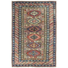Antique Caucasian Rug with Six Central Medallions & Intricate Geometric Borders