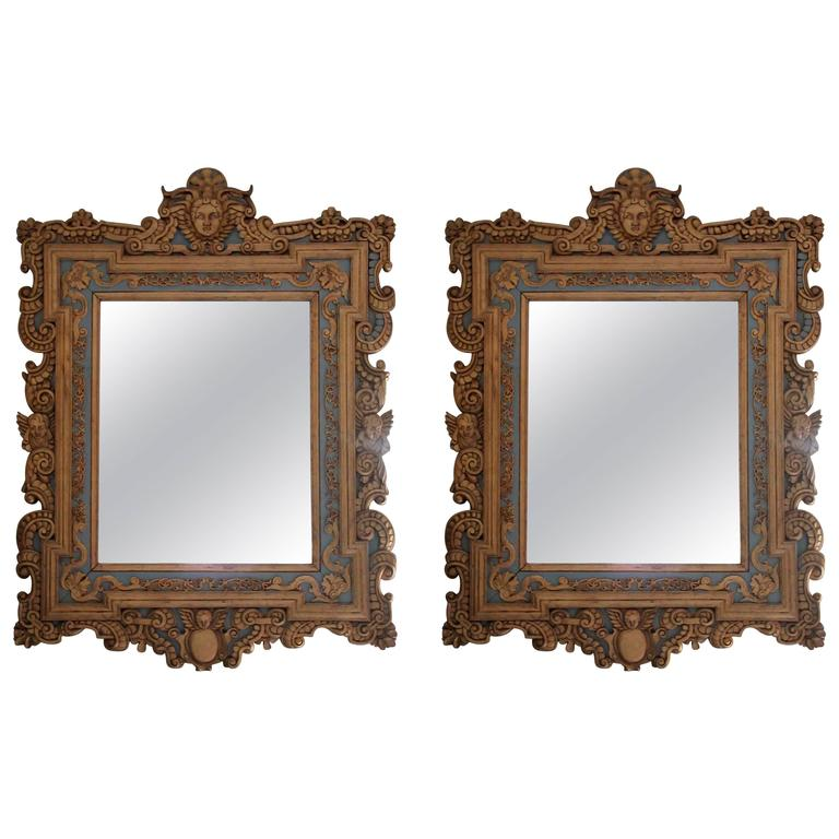 Pair of Giltwood Cherub Theme Wall Mirrors For Sale
