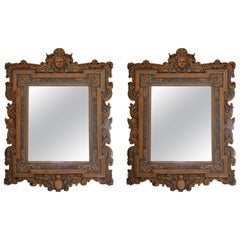 Pair of Giltwood Cherub Theme Wall Mirrors