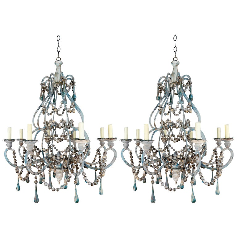 Pair of Eight-Light Wood Beaded and Metal Painted Chandeliers