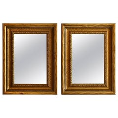 Pair of Gilt-wood Framed Antiqued Silver Mirrors, Early 20th Century
