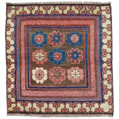 Early 19th Century Rose and Blue Khotan Fragment Rug