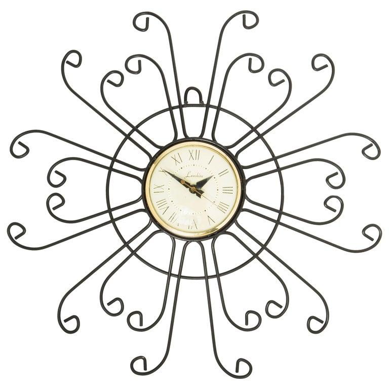 Lanshire Curled Iron Sunburst Clock, circa 1950