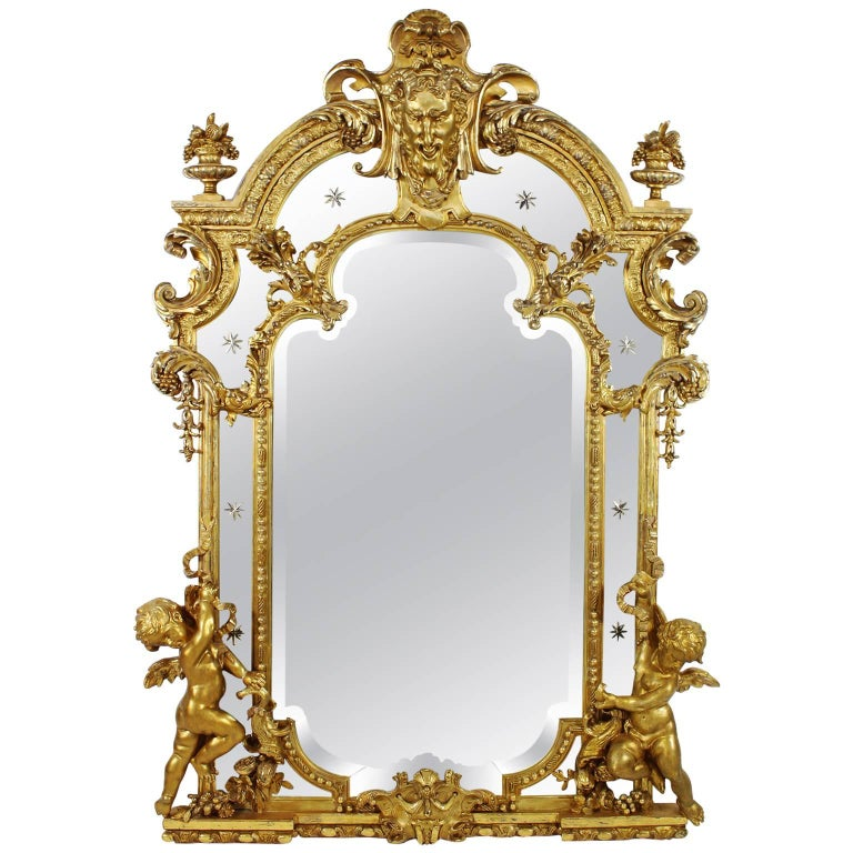 French 19th Century Louis XV Style Giltwood and Gesso Carved Mirror with Cherubs