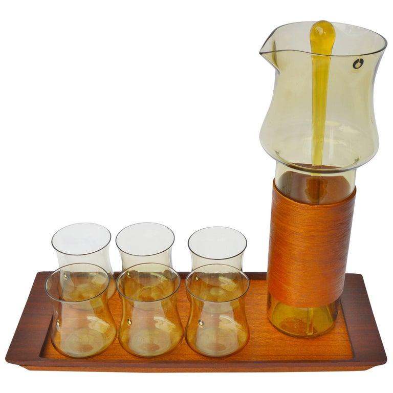Goran Warff Pukeberg Amber Glass Pitcher & Six Glasses, Stir Stick & Teak Tray For Sale