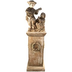 Hand-Carved Limestone Statue of Children on Tall Wreathed Pedestal