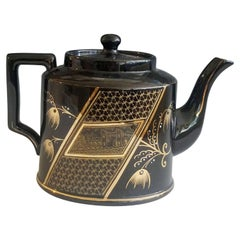 Aesthetic Movement Pottery Teapot and Cover, circa 1885