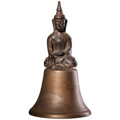 Unusual Bronze-Silver Alloy Buddha Seated on a Bell