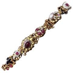 14 Karat Yellow Gold Watch Bracelet with Six Gem Set Charms
