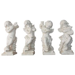 Set of Four Baroque Style Marble Cherub Musicians