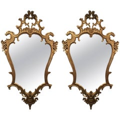 Pair of Italian Rococo Style Carved Giltwood Mirrors, Early 20th Century