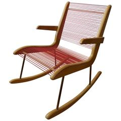 Modernist String Wood and Iron Rocking Chair by Carl Koch