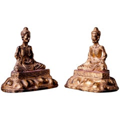 Two Gilded and Lacquered Bronze Fasting Buddha