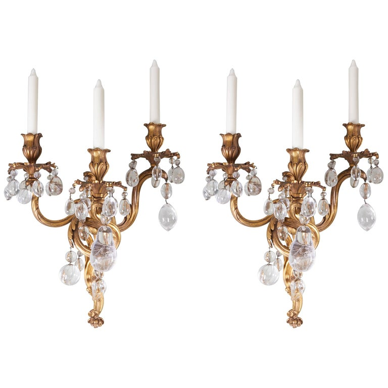 A Pair of Louis XV Style Bronze Dore and Rock Crystal Sconces